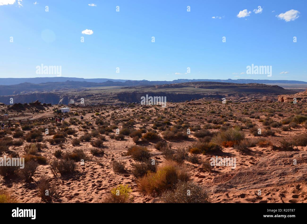 Horseshoe Bend near the town of Page in Arizona, people are walking to the outlook area, September, blue sky, sunny, desert landscape, landmark - Stock Image