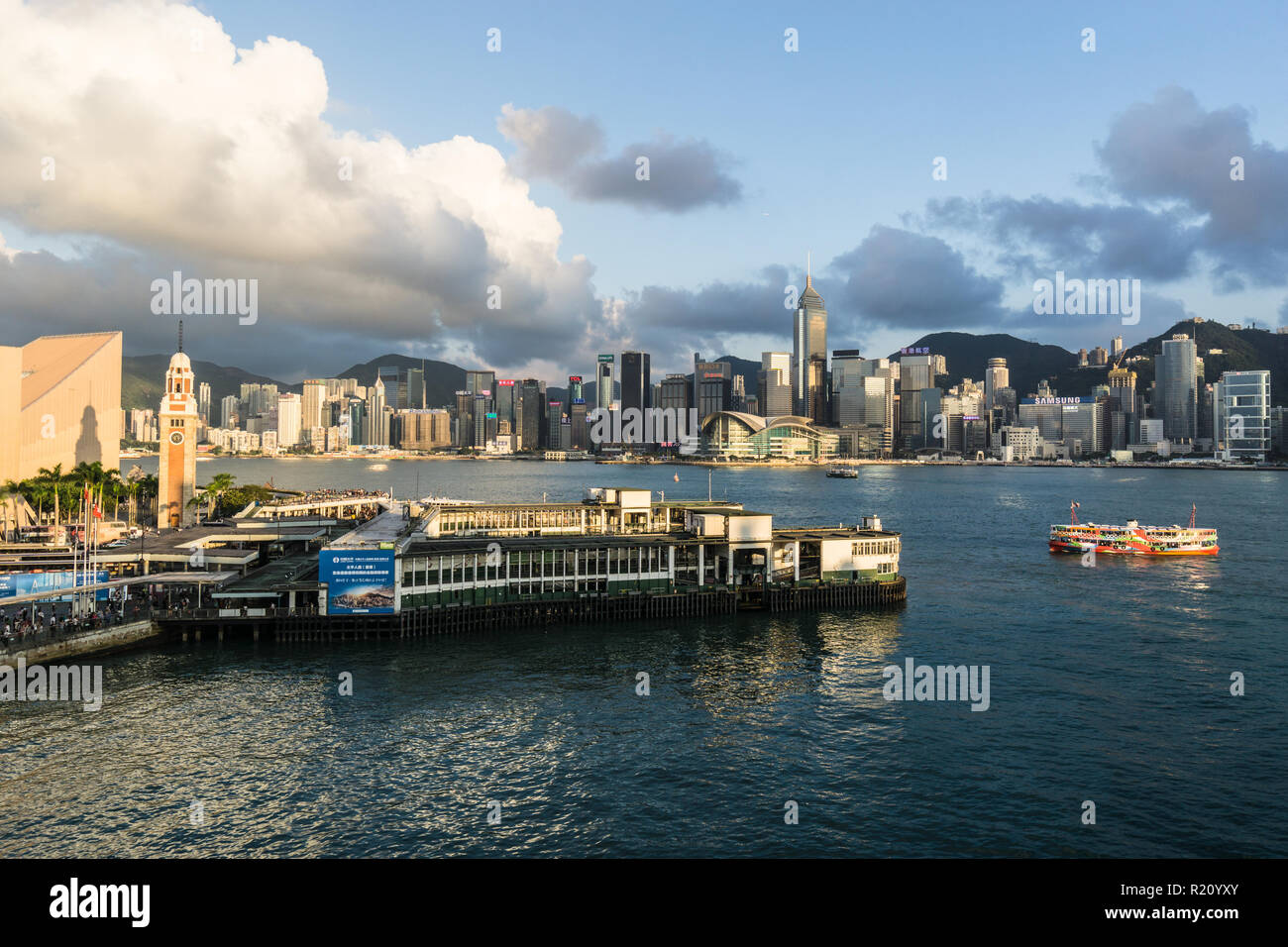 Hong Kong, China - May 15 2018: Aerial view of a Star Ferry  reaching his pier in Kowloon with Hong Kong island skyline. - Stock Image