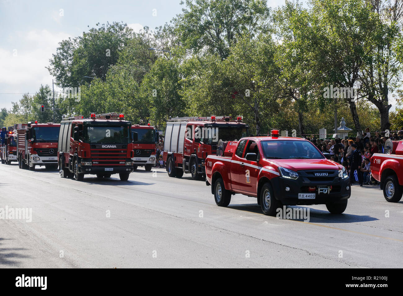 Greek Fire Service trucks during Oxi Day parade in Thessaloniki, Greece. Hellenic Fire Brigade vehicles with Greek firefighters in uniform. - Stock Image