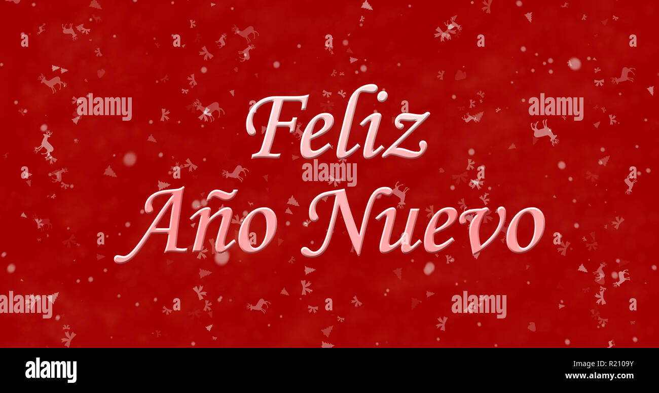 Happy New Year text in Spanish 'Feliz ano nuevo' on red background - Stock Image