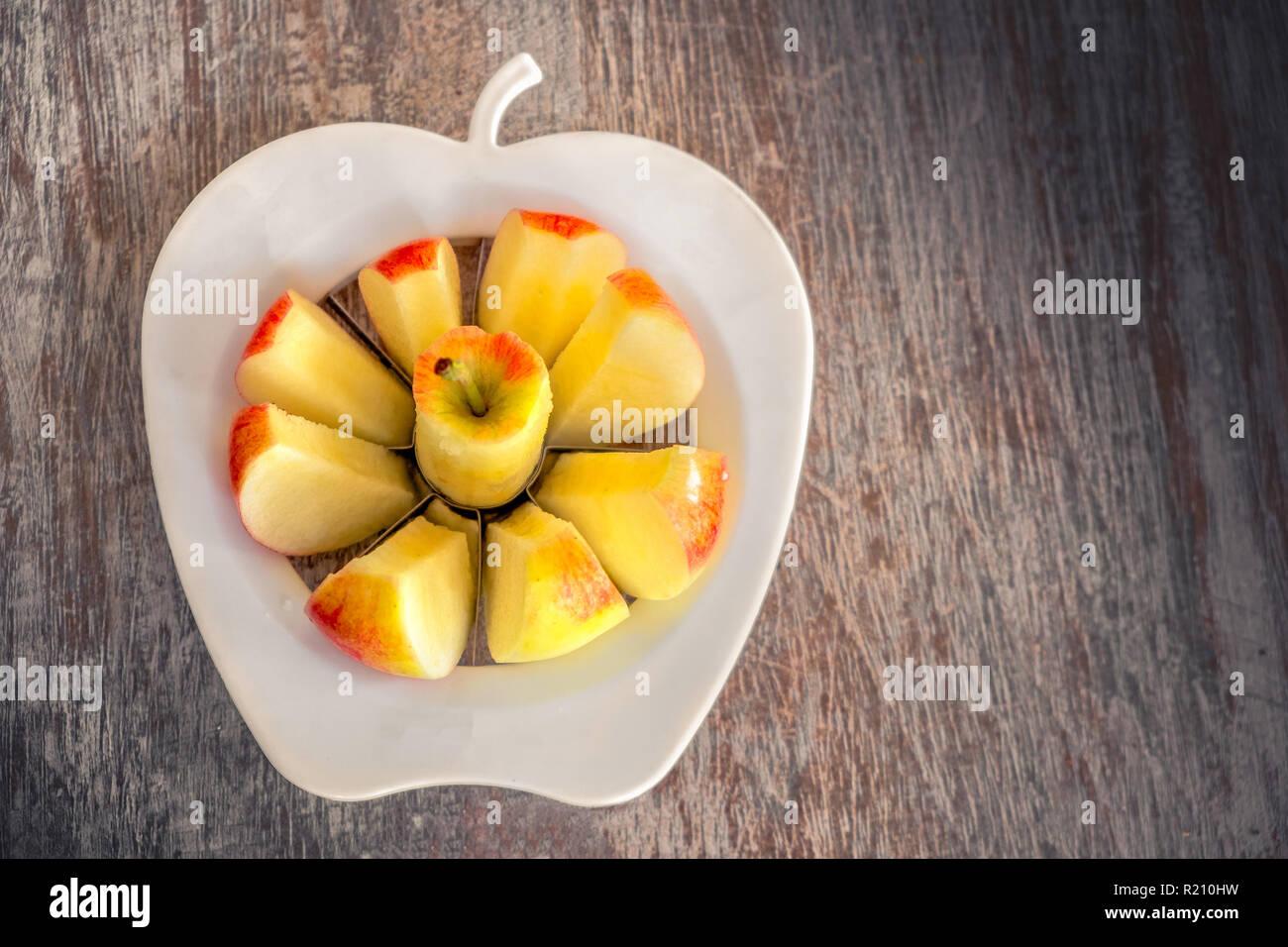apple slices clean eating background apple corer slicer - Stock Image
