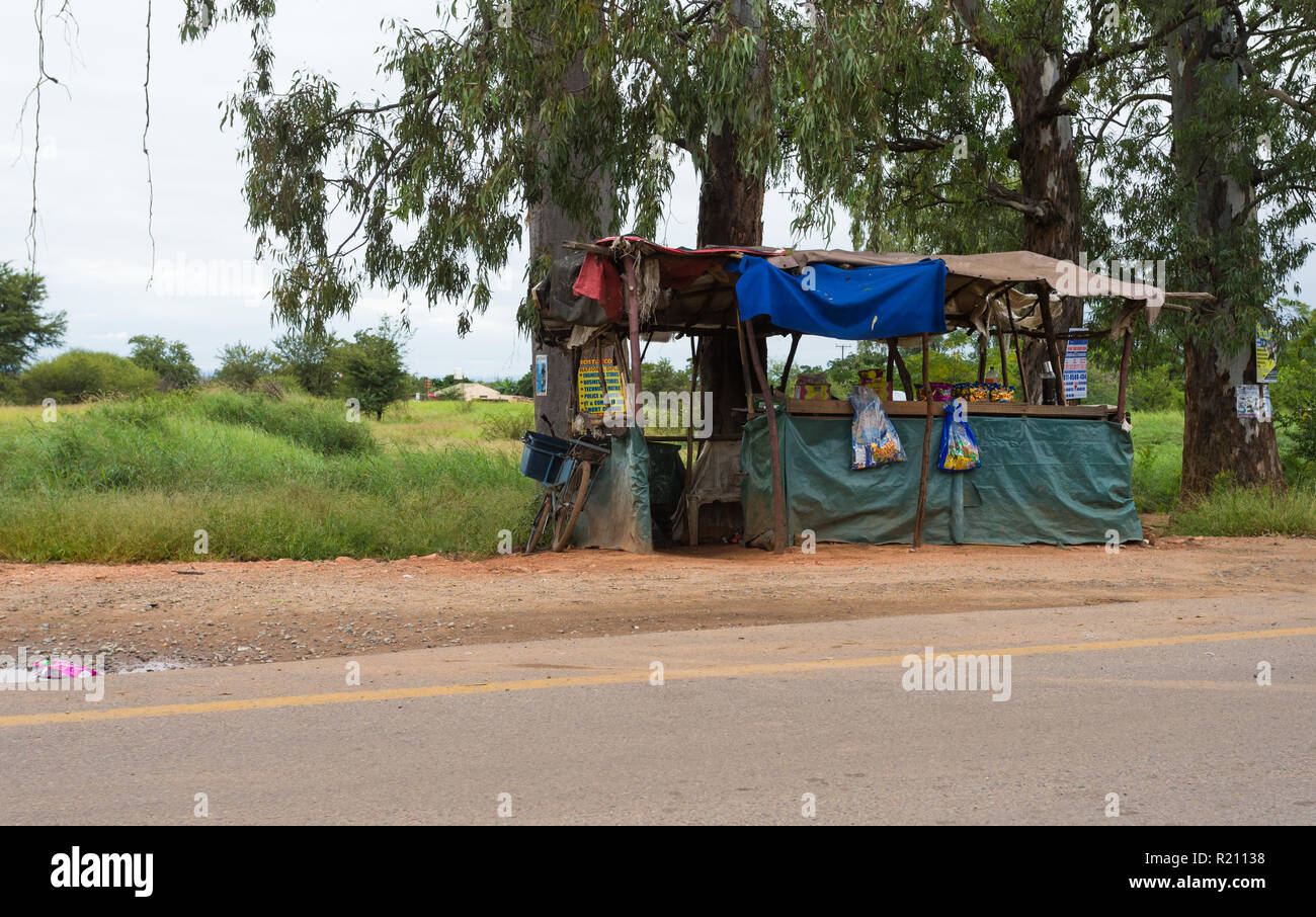 makeshift tuck shop or refreshment vendor on the side of the road in a rural village in South Africa - Stock Image