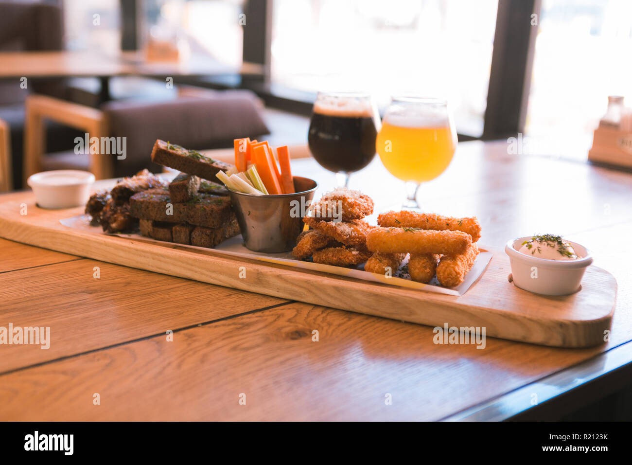 Close up of unhealthy food that being cooked in pub - Stock Image