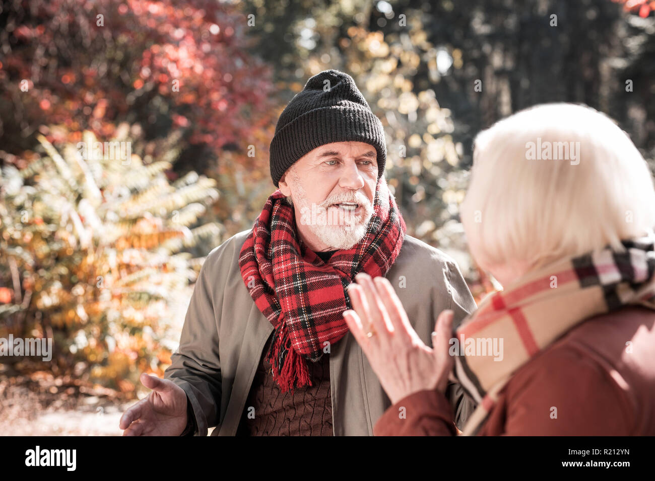 Cheerless sad man having an argument with his wife - Stock Image