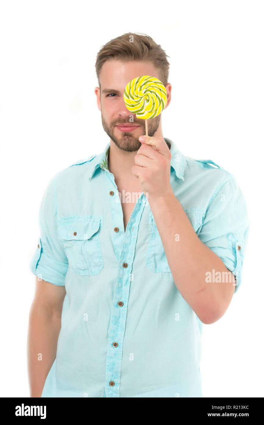 Check your vision. Man holds big lollipop in front of eye. Guy concentrated face passing vision test isolated white. Man visiting ophthalmology room. You should visit ophthalmologist to check vision. - Stock Image