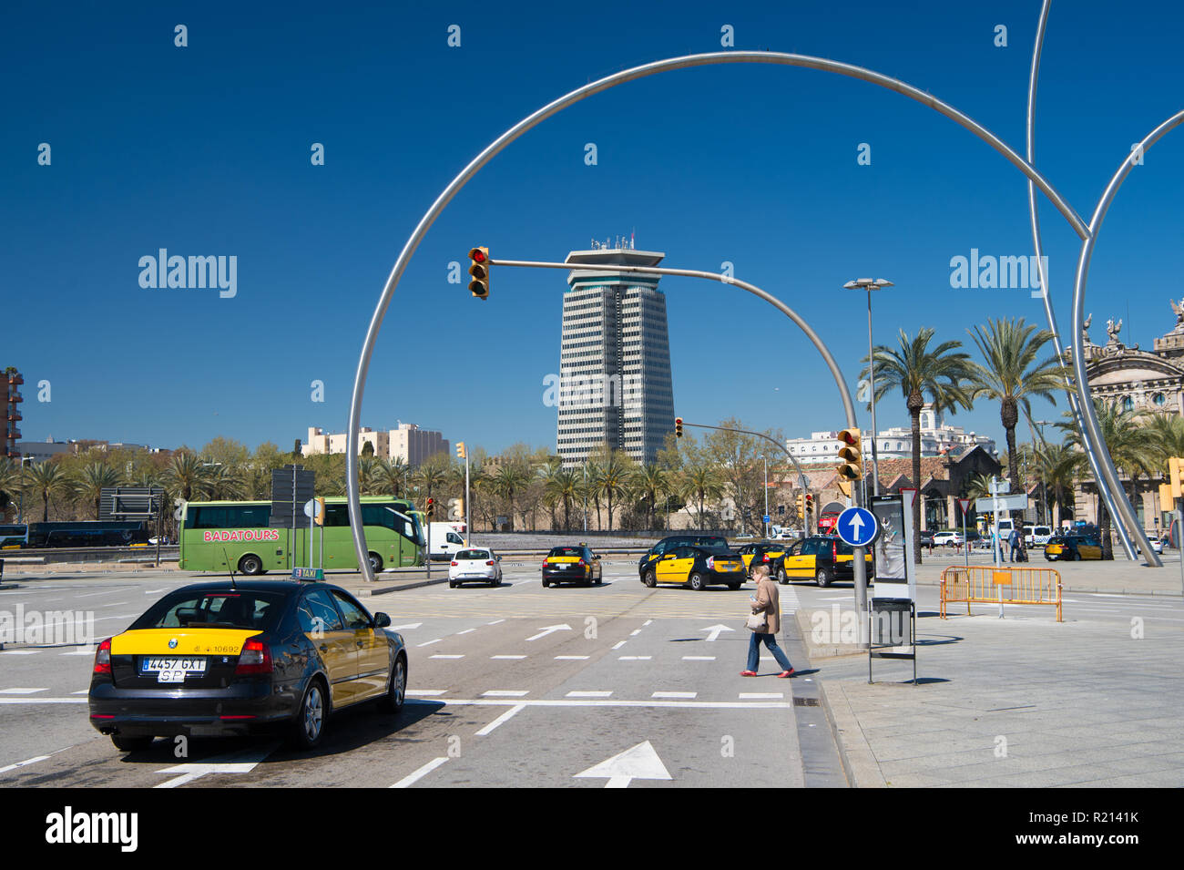 Barcelona, Spain - March 30, 2016: city crossroad and crosswalk with traffic lights. Intersection. Urban road. Town buildings on blue sky. Transportation in traffic jam. Travelling and wanderlust. - Stock Image