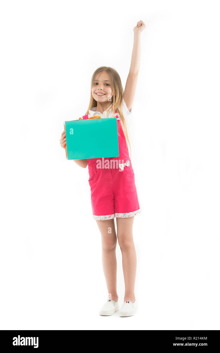 Wait to buy. Girl cute teenager carries shopping bag. Shopping discount. Kid bought clothing summer sale. Loyalty program benefits. Loyalty programs remain extremely popular with consumers. - Stock Image