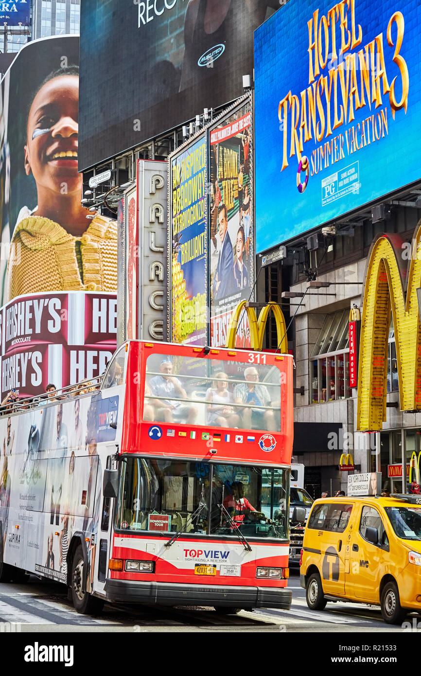New York City, USA - June 29, 2018: Tourist bus at the Times Square, often referred as the commercial and consumerism heart of the world. - Stock Image