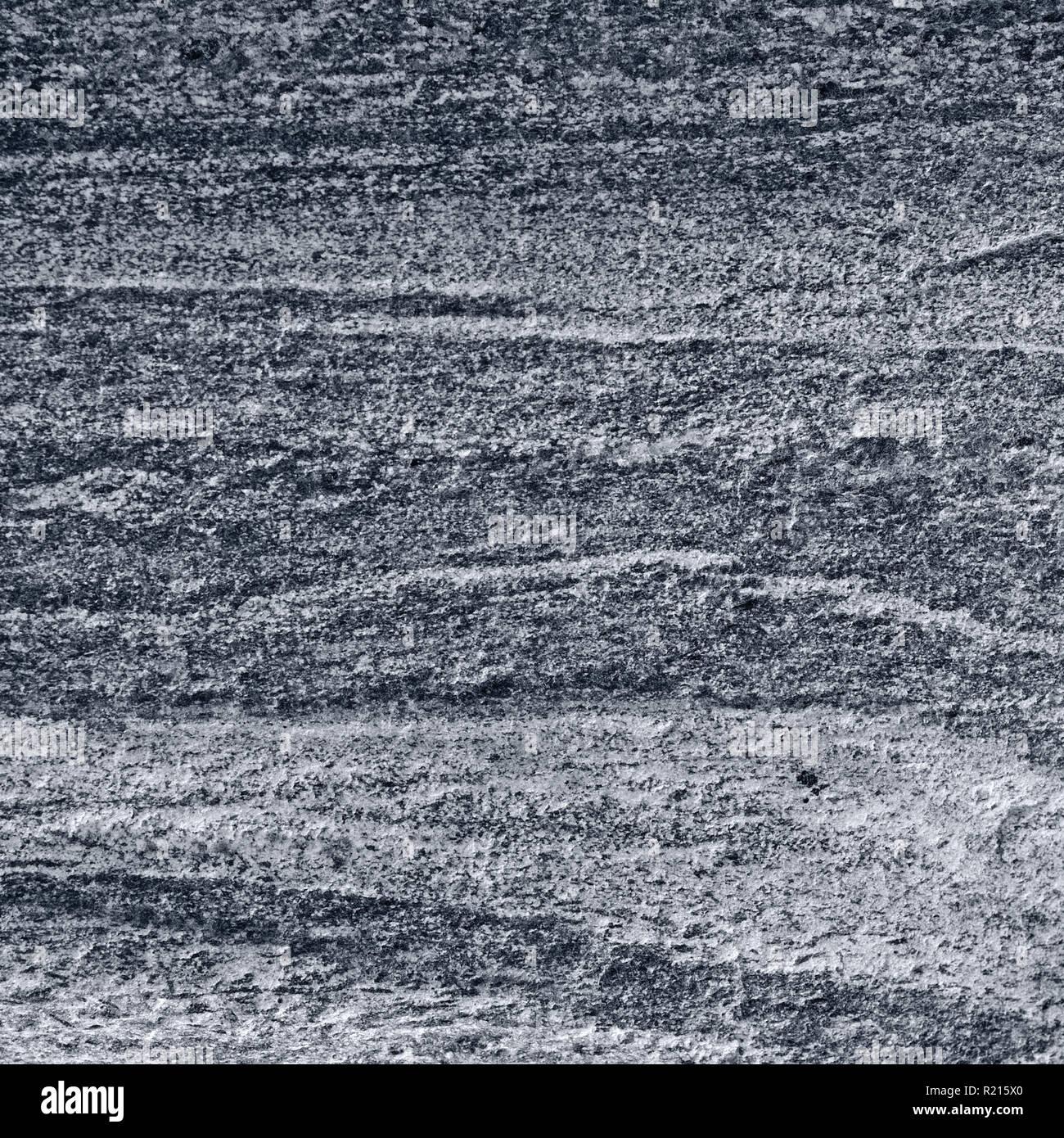 Migmatitic gneiss migmatite rock bands pattern, grey light dark banded granite texture macro closeup, large detailed textured silver gray horizontal Stock Photo