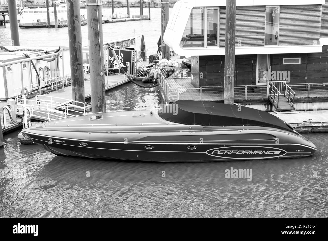 Hamburg, Germany - September 07, 2017: motor boat at pier in Elbe harbor. Water transport transportation. Adventure, discovery journey. Traveling travelling, travel trip, wanderlust vacation - Stock Image