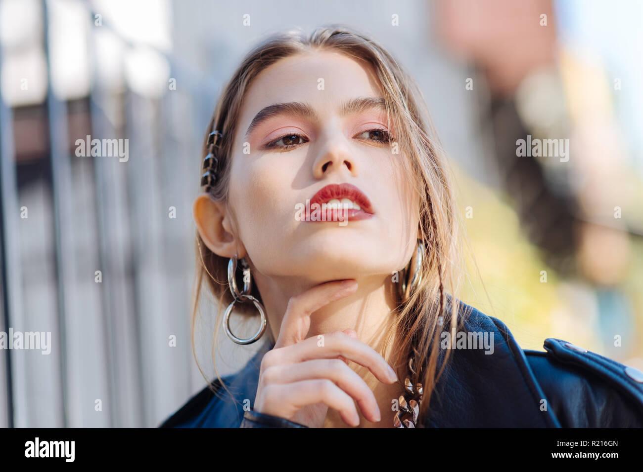 Extremely beautiful photo model feeling joyful posing for cover - Stock Image