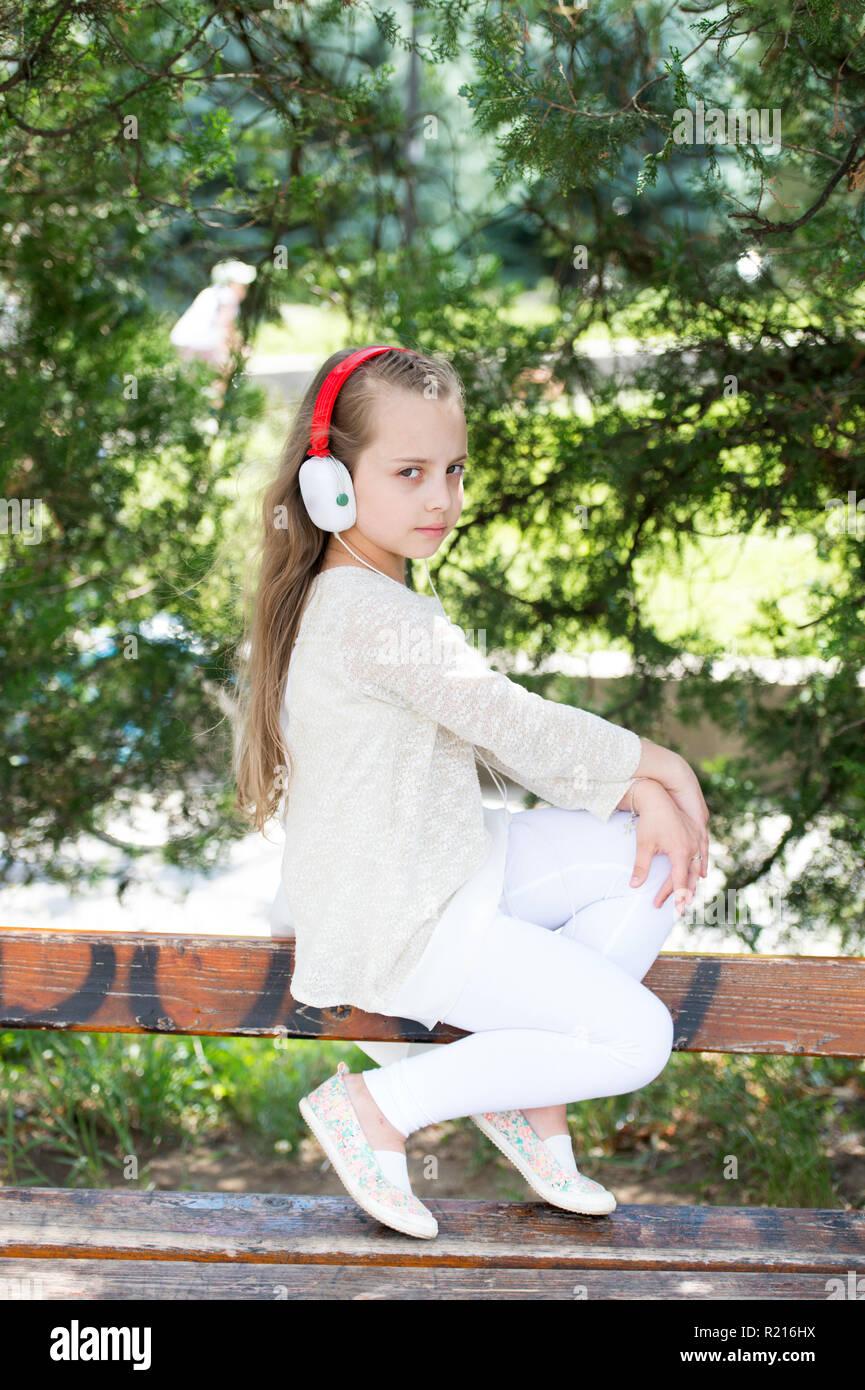 Music sound and mp3  Little girl listen music in summer park  Child