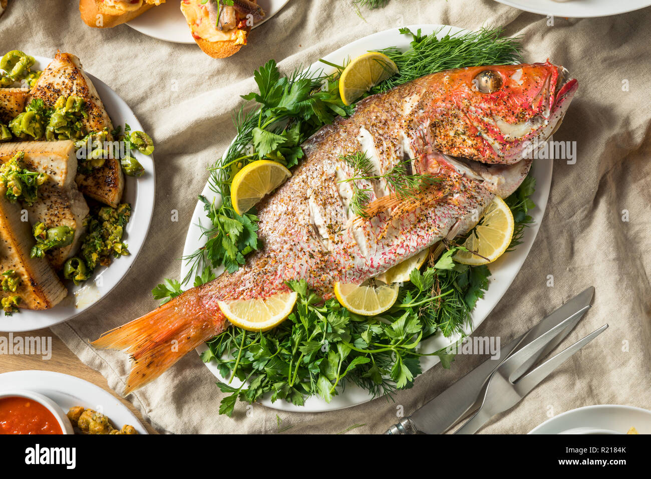 Holiday Italian Feast of 7 Fishes with Snapper Octopus and Pasta - Stock Image