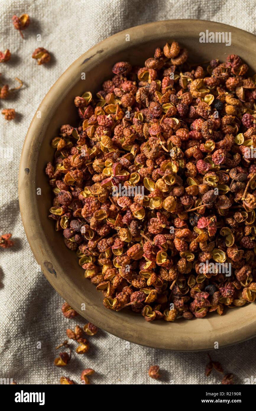 Raw Organic Dry Szechuan Peppercorns in a Bowl Stock Photo