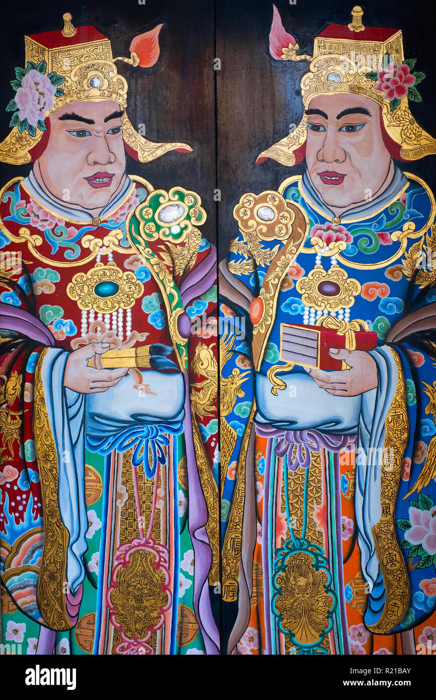 Paintings on a door at Thian Hock Keng Temple in Telok Ayer Street, Chinatown, Singapore, depicting wealthy traders - Stock Image