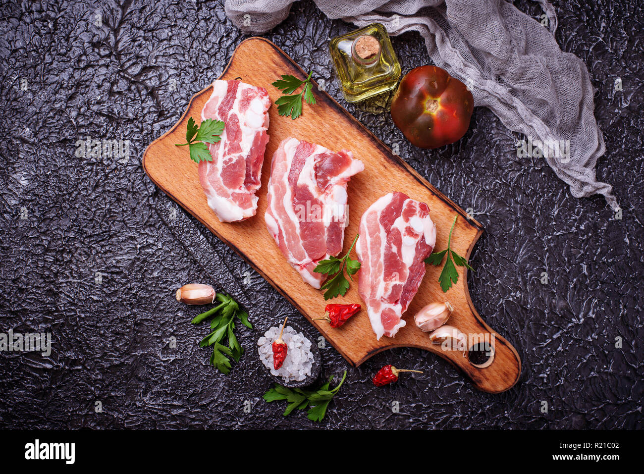 Raw pork meat and ingredients for cooking - Stock Image