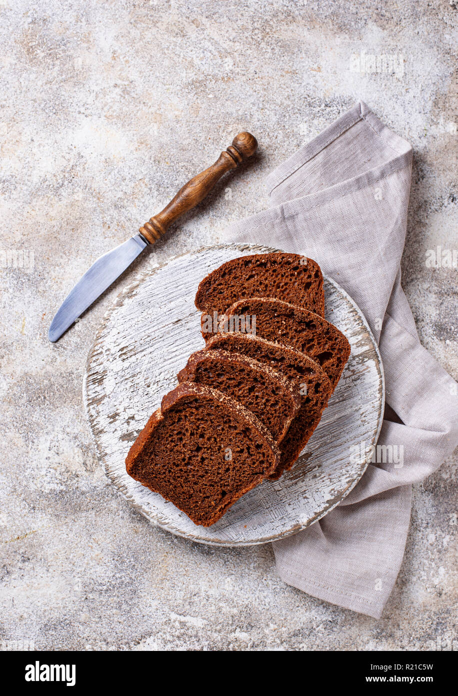 Fresh sliced rye bread on light background - Stock Image