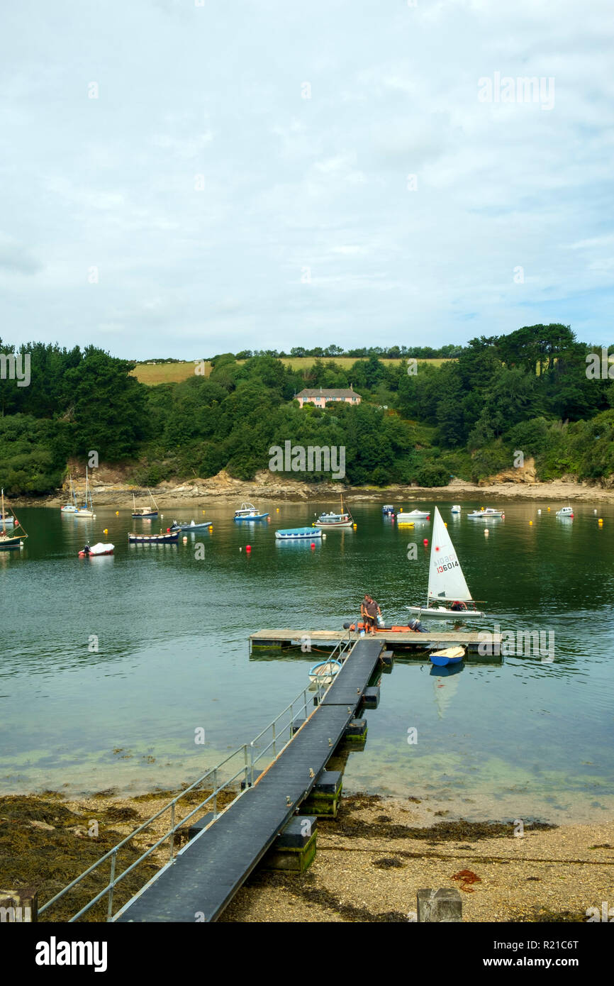 St Just in Roseland, UK - 25th July 2017: A calm summer morning brings people out to their small boats on the creek at St Just in Roseland on the picturesque Roseland Peninsula in Cornwall, UK Stock Photo
