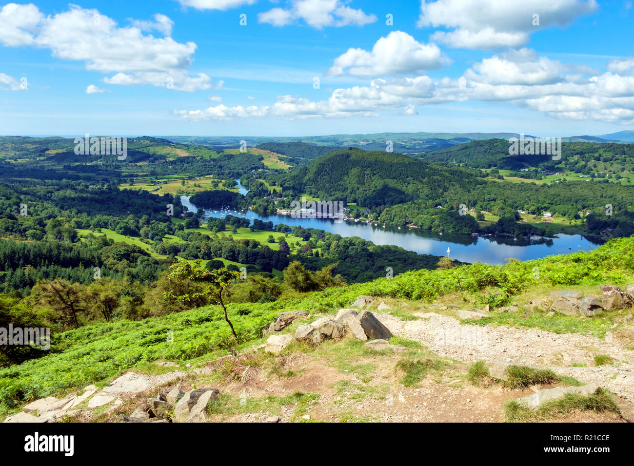 The view over south end of Lake Windermere from the path to Gummers How on a beautiful summer morning. Gummers How is a well known viewpoint in The Lake District, Cumbria, UK. - Stock Image