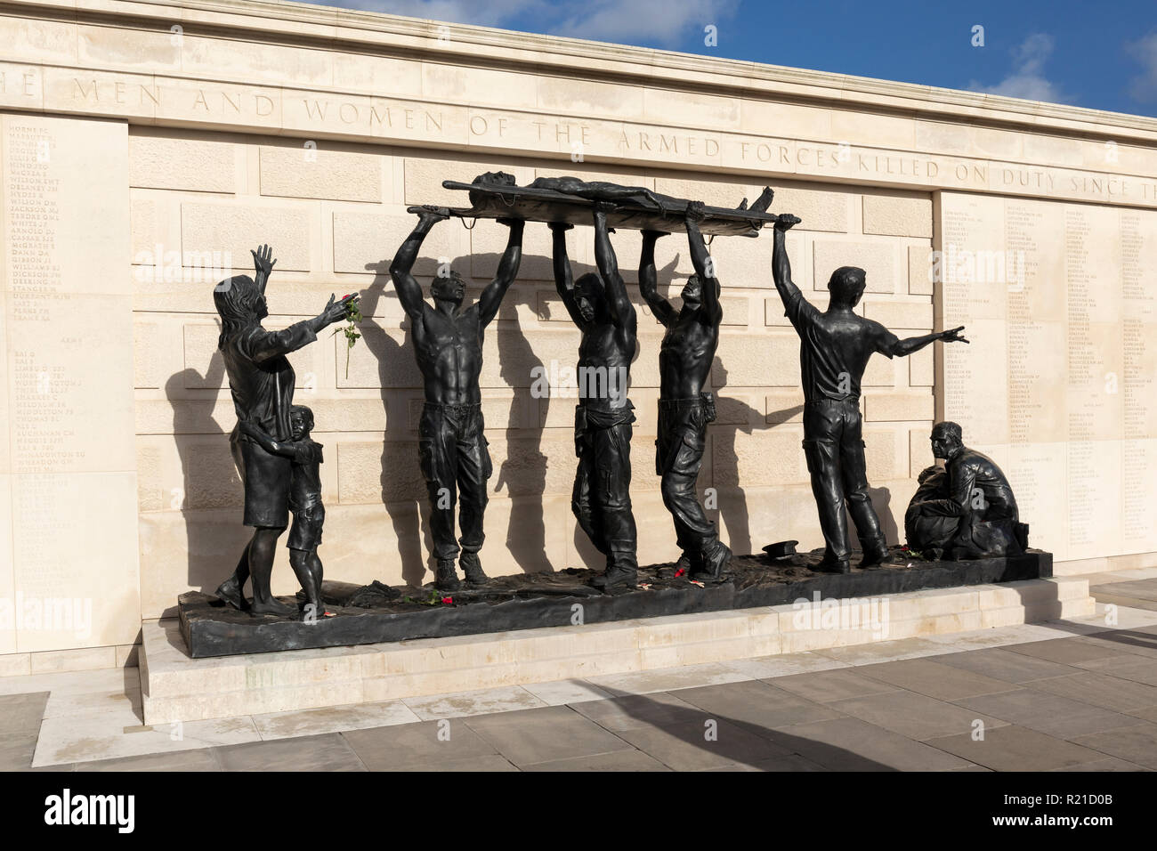 The bronze Stretcher Bearers sculpture in The Armed Forces Memorial, National Memorial Arboretum, Staffordshire - Stock Image
