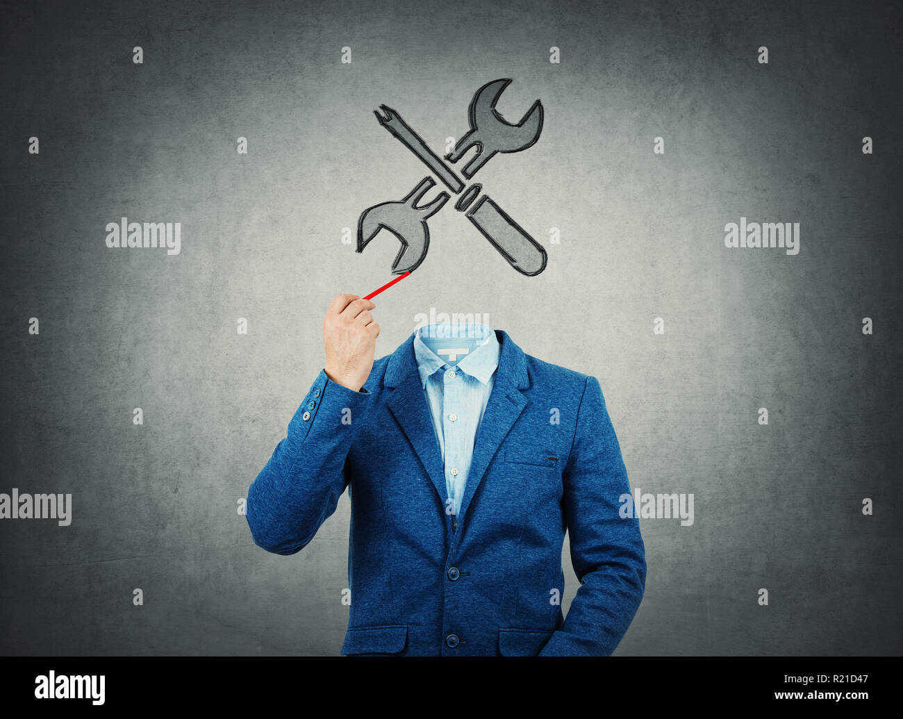 Surreal image as a businessman with invisible face holding a pencil in his hand draw wrench and screwdriver tools iconl instead of head. Bussiness rep - Stock Image