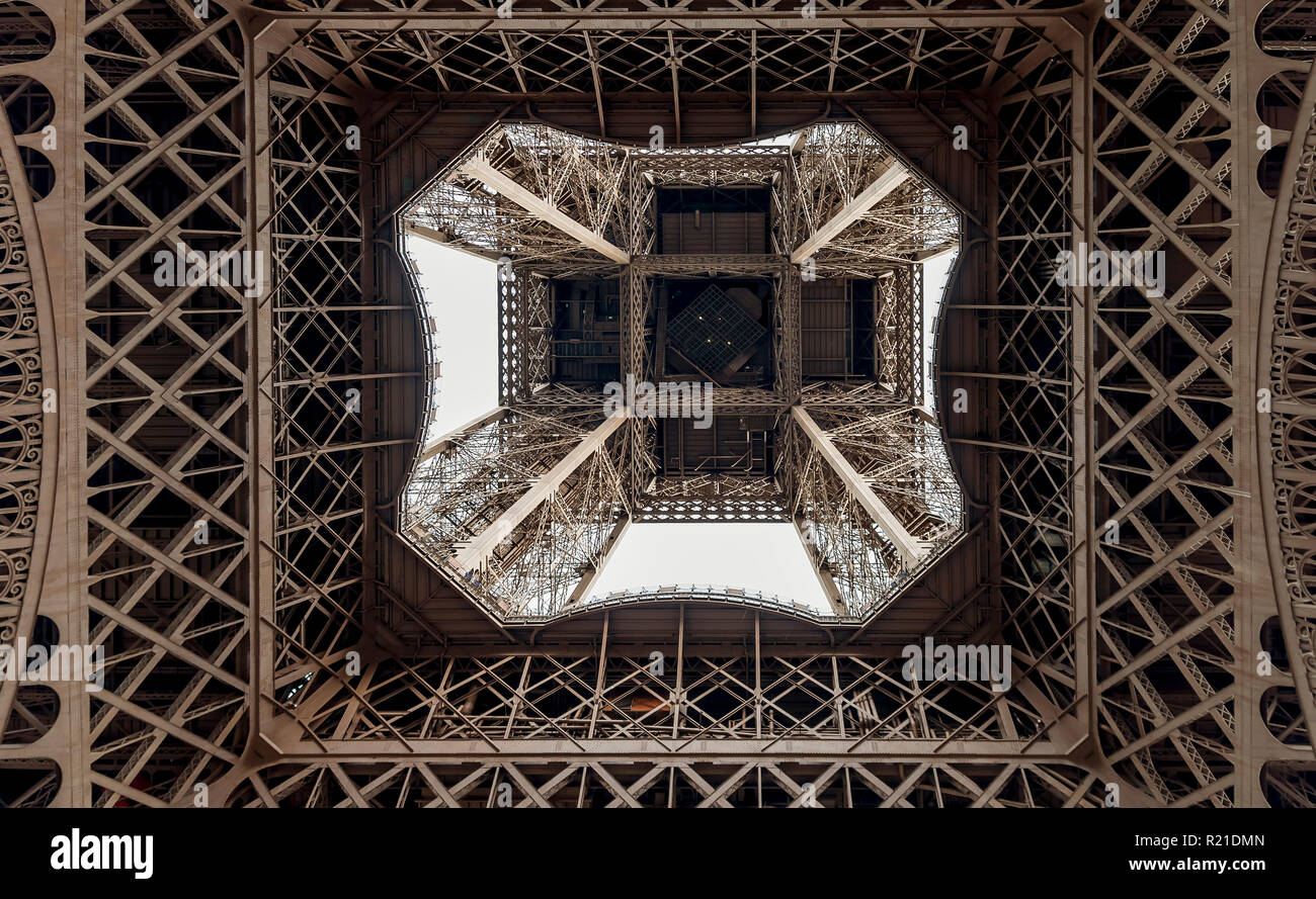 Graphic image of the Eiffel Tower seen from below, Paris, France - Stock Image