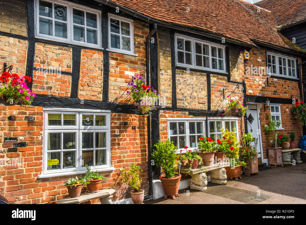Historic timber-framed brick building in Old Amersham, Buckinghamshire, England - Stock Image