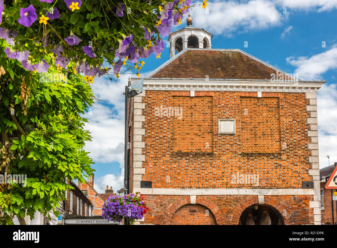 Flowers outside Old Amersham Market Hall, Amersham, Buckinghamshire, England - Stock Image