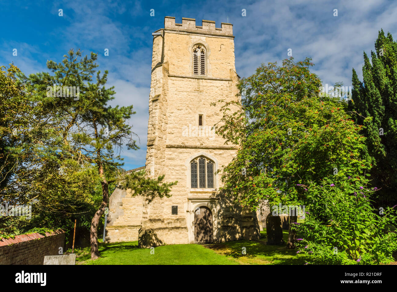 Sunlight on the west tower of medieval St Mary's Church in the Buckinghamshire village of Pitstone, England - Stock Image