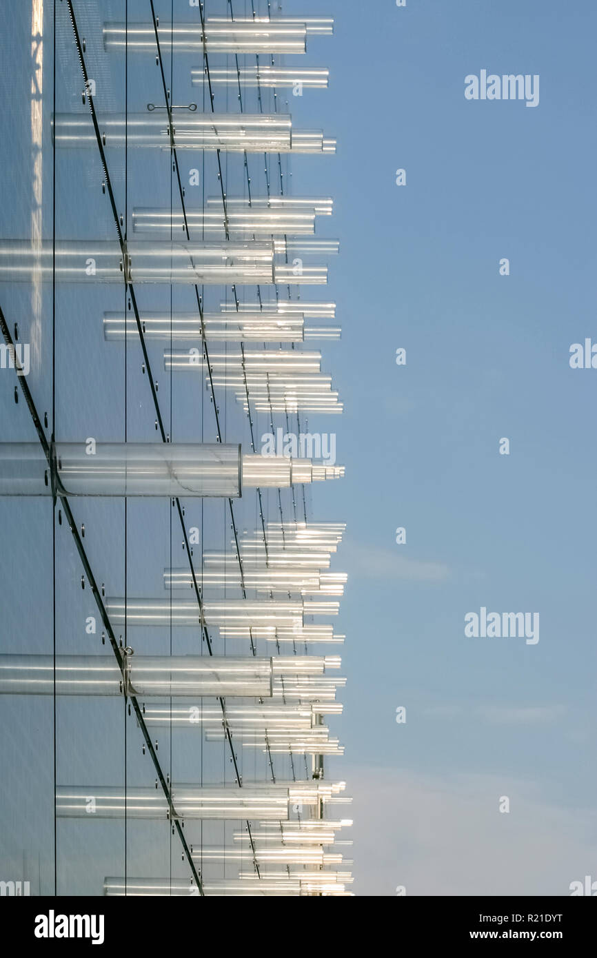 Exterior facade of the Galleria Krakowska shopping centre in Krakow, Poland, with glass panels and decorative transparent tubes or cylinders - Stock Image