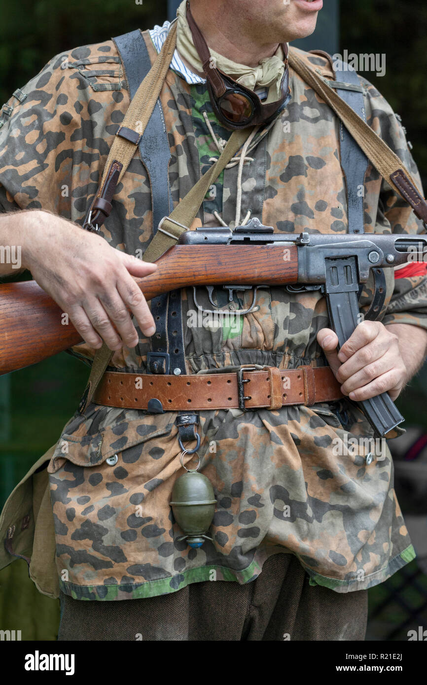 World War 2 reenacter dressed as a Polish resistance fighter and carrying a Russian PPSH-41 sub machine gun, at the Durham Light Infantry Museum, UK Stock Photo