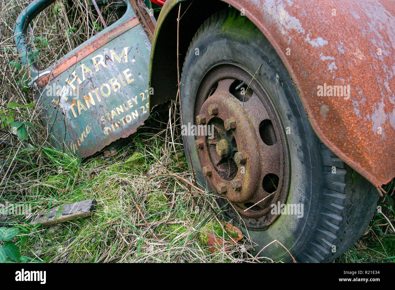 Abandoned old derelict and rusty 1940's Bedford M Series or O Series truck on waste ground surrounded by weeds and grass, County Durham UK - Stock Image