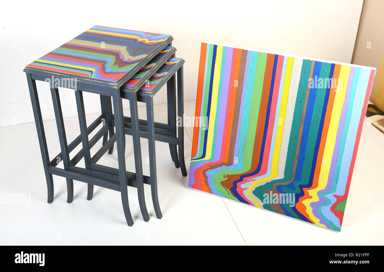 Shabby Chic furniture with matching painting made from old tables - Stock Image