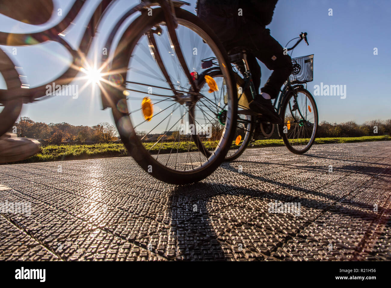 First solar cycle path in Germany, in Erftstadt, a 90 meter long test track with solar modules on the ground, that produce electricity - Stock Image