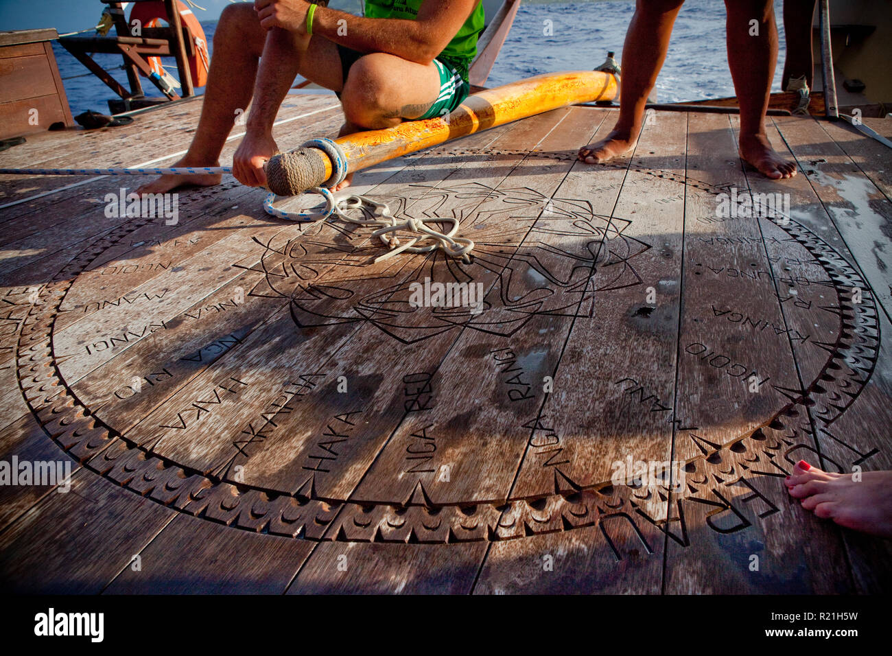 Aid to celestial navigation carved into the deck of the Marumaru Atua, a 22-metre modern 'vaka' built in the style of traditional Polynesian ships. - Stock Image