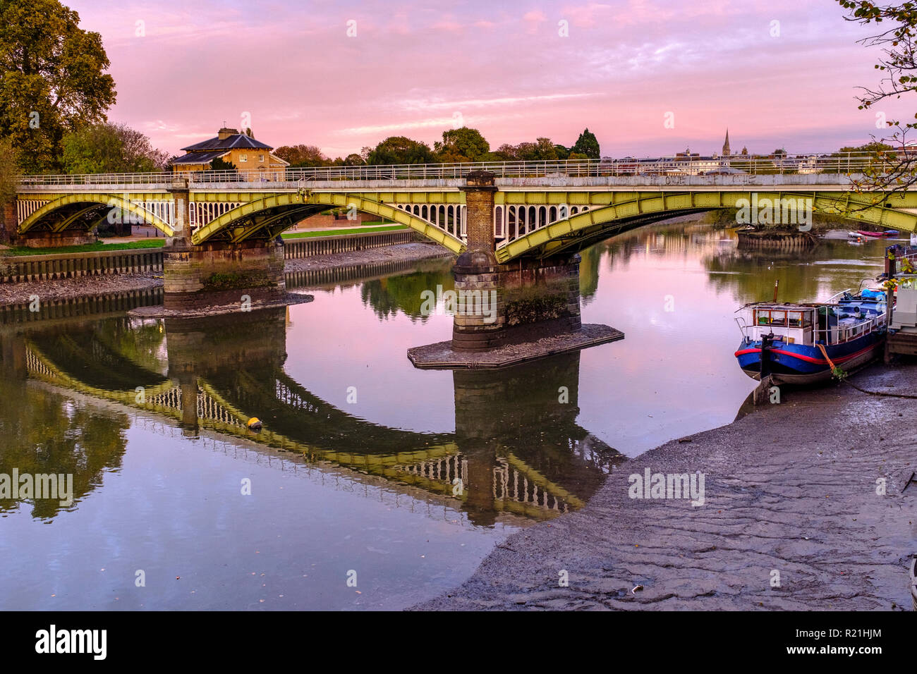 England,Ricgmond-Upon-Thames.River Thames at low tide and Twickenham railway Bridge - Stock Image