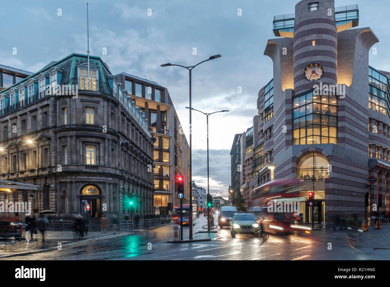 England,London- traffic on Bank Station Junction, City of London Magistrate Court to the left, Queen Victoria Street and Poultry to the right - Stock Image