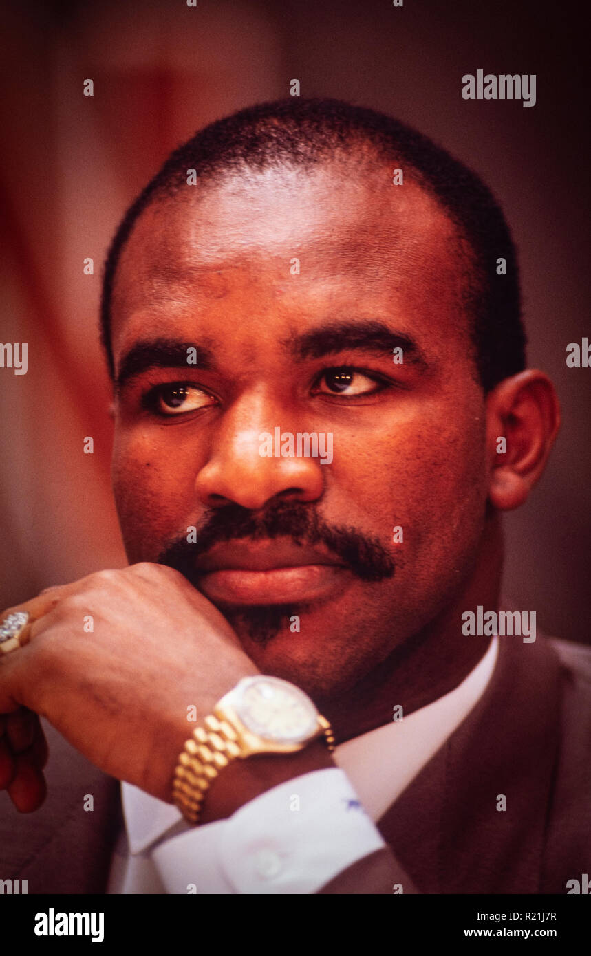 Evander Holyfield during a press conference in Atlanta in 1991 announcing his match against George Foreman. Holyfield is an American former professional boxer who competed from 1984 to 2011. He reigned as the undisputed champion at cruiserweight in the late 1980s and at heavyweight in the early 1990s, and remains the only boxer in history to win the undisputed championship in two weight classes. Nicknamed 'The Real Deal', Holyfield is the only four-time world heavyweight champion, having held the unified WBA, WBC and IBF titles from 1990 to 1992. - Stock Image
