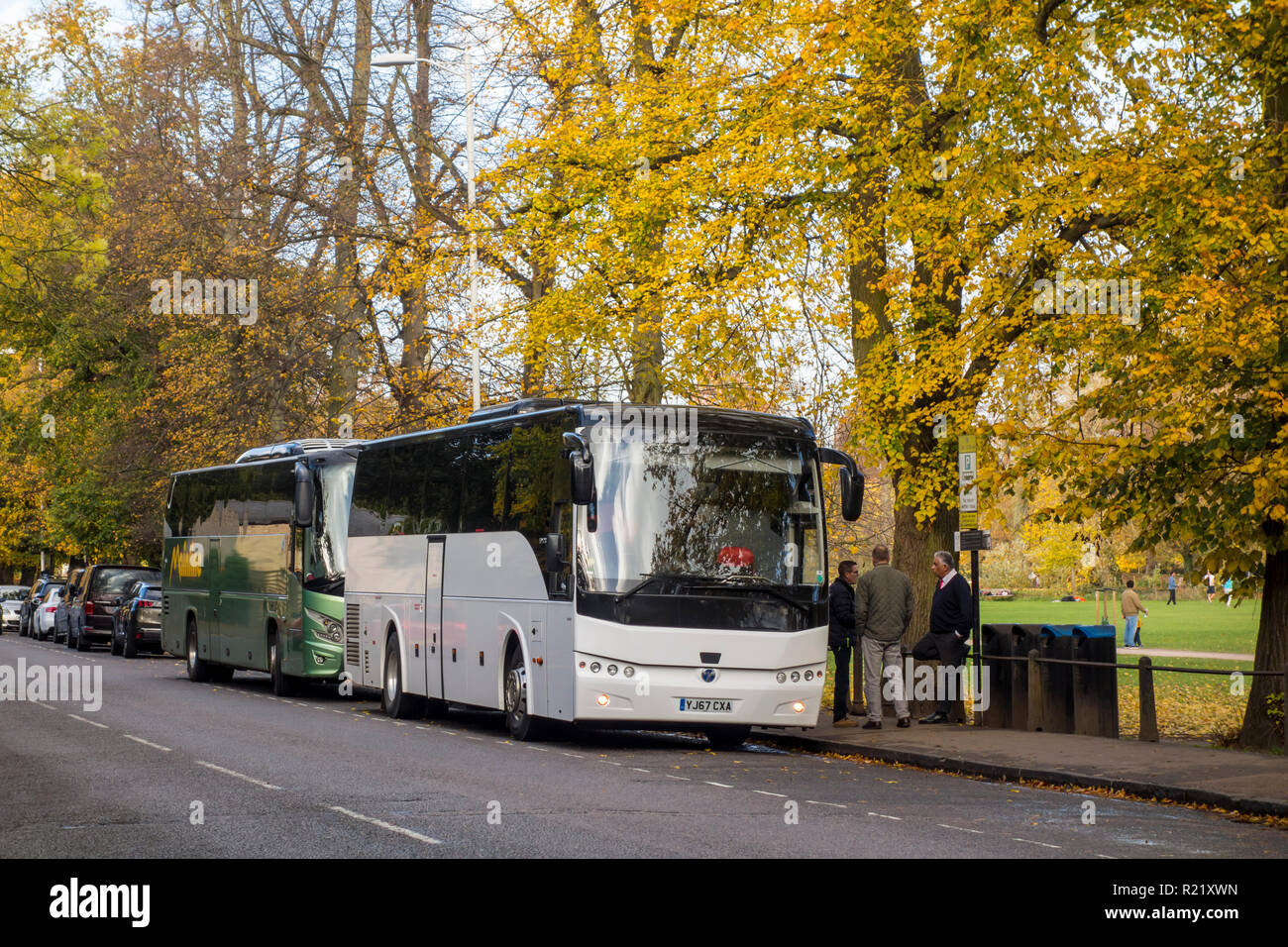 Tourist coaches and buses parked on The Backs in Cambridge, UK during Autumn - Stock Image