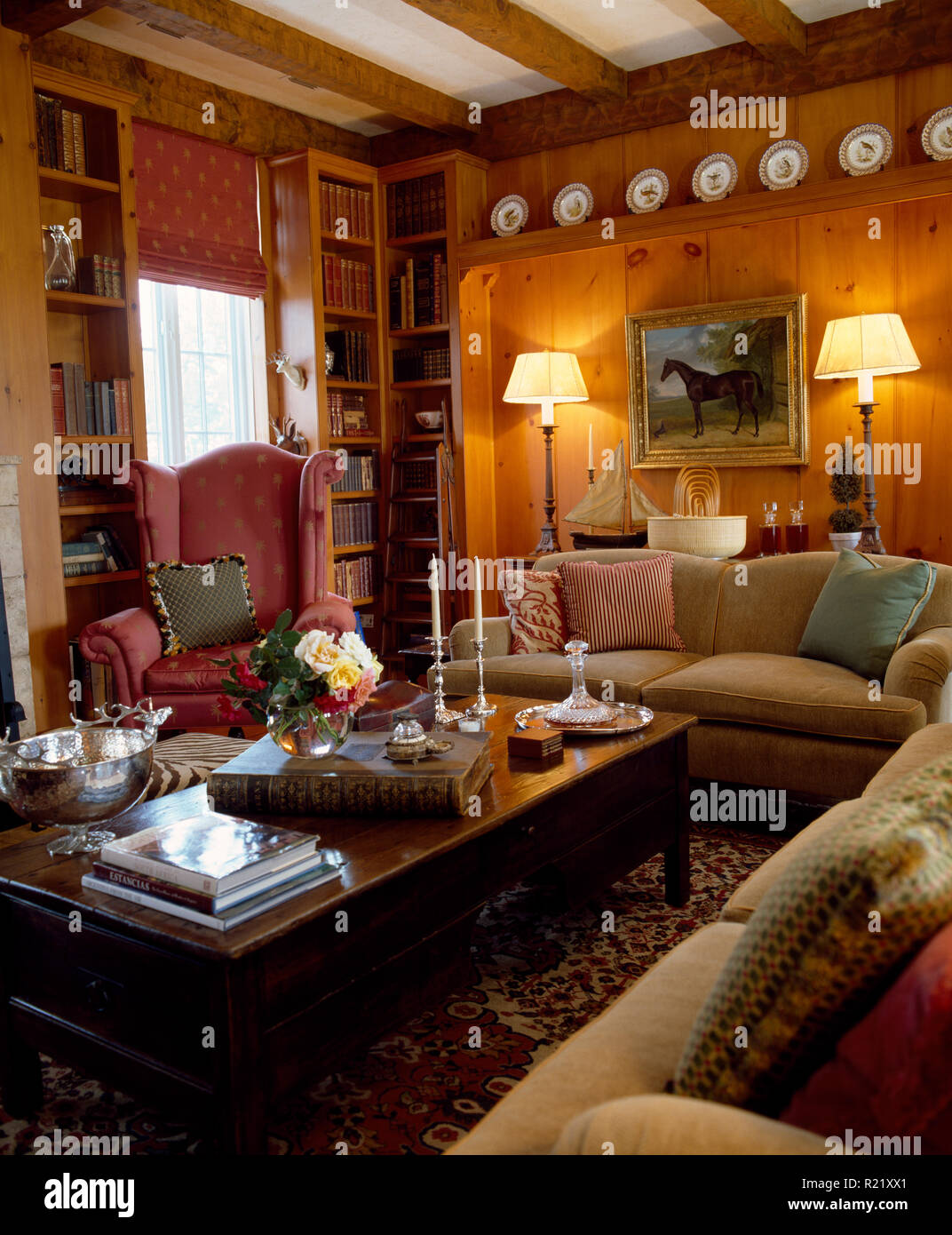 Lighted lamps and vintage wooden coffee table in sitting room
