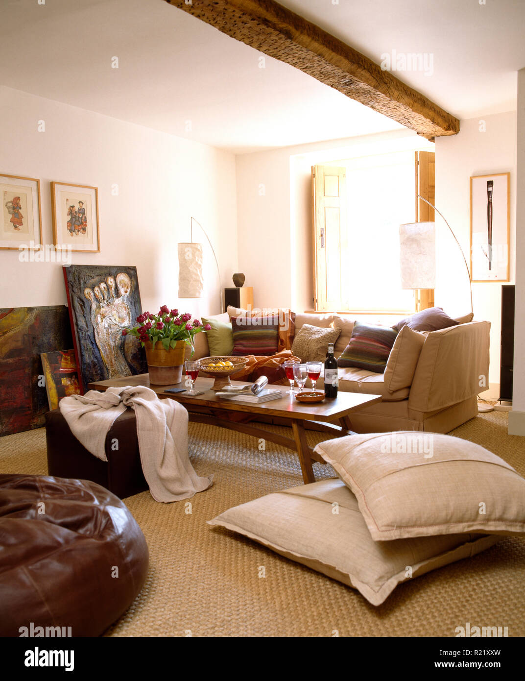 Cream floor cushions and carpet in white sitting room Stock ...