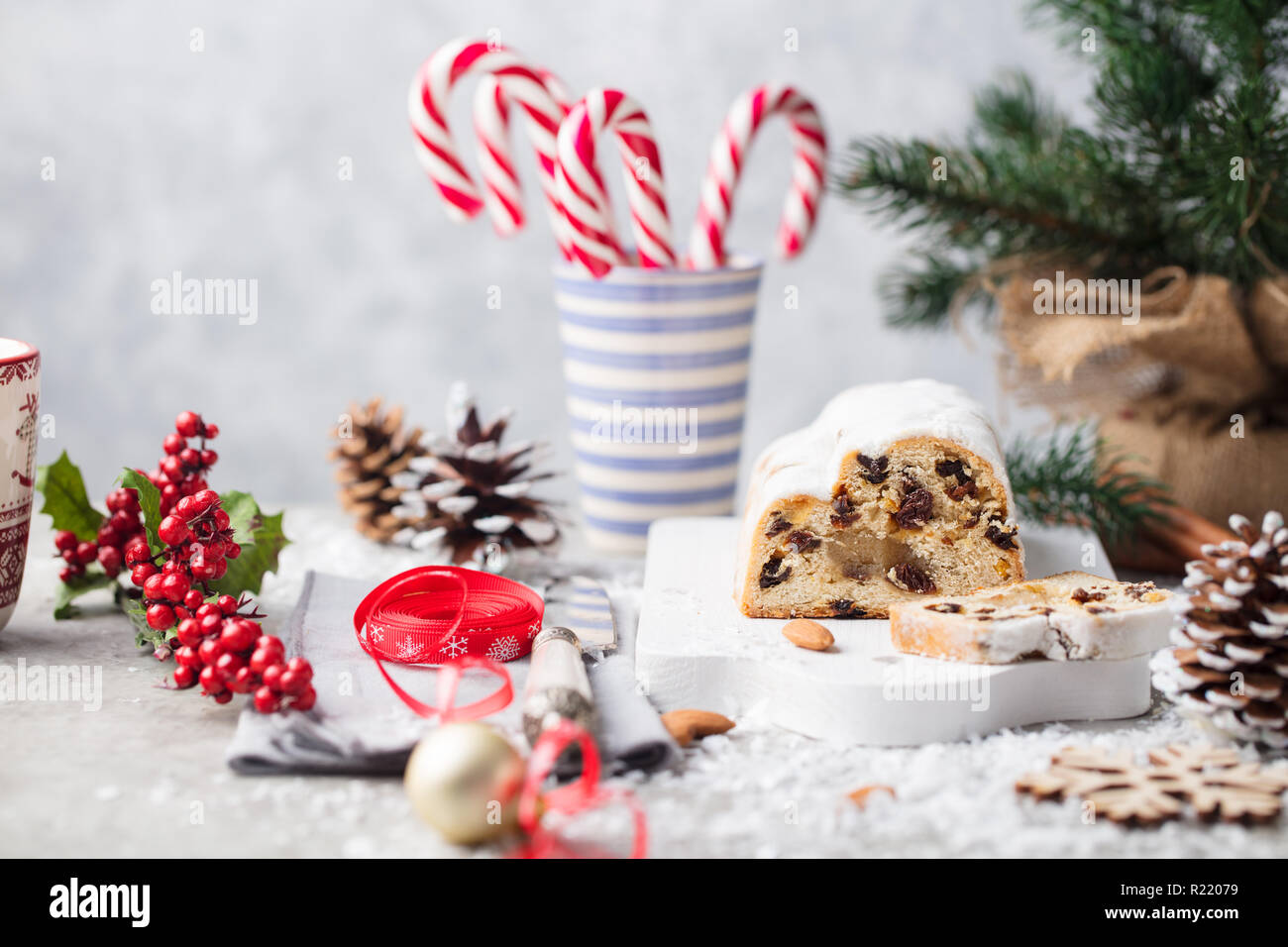 Christmas stollen cake with icing sugar, marzipan and raisins. Traditional Dresdner christ pastry. Stock Photo