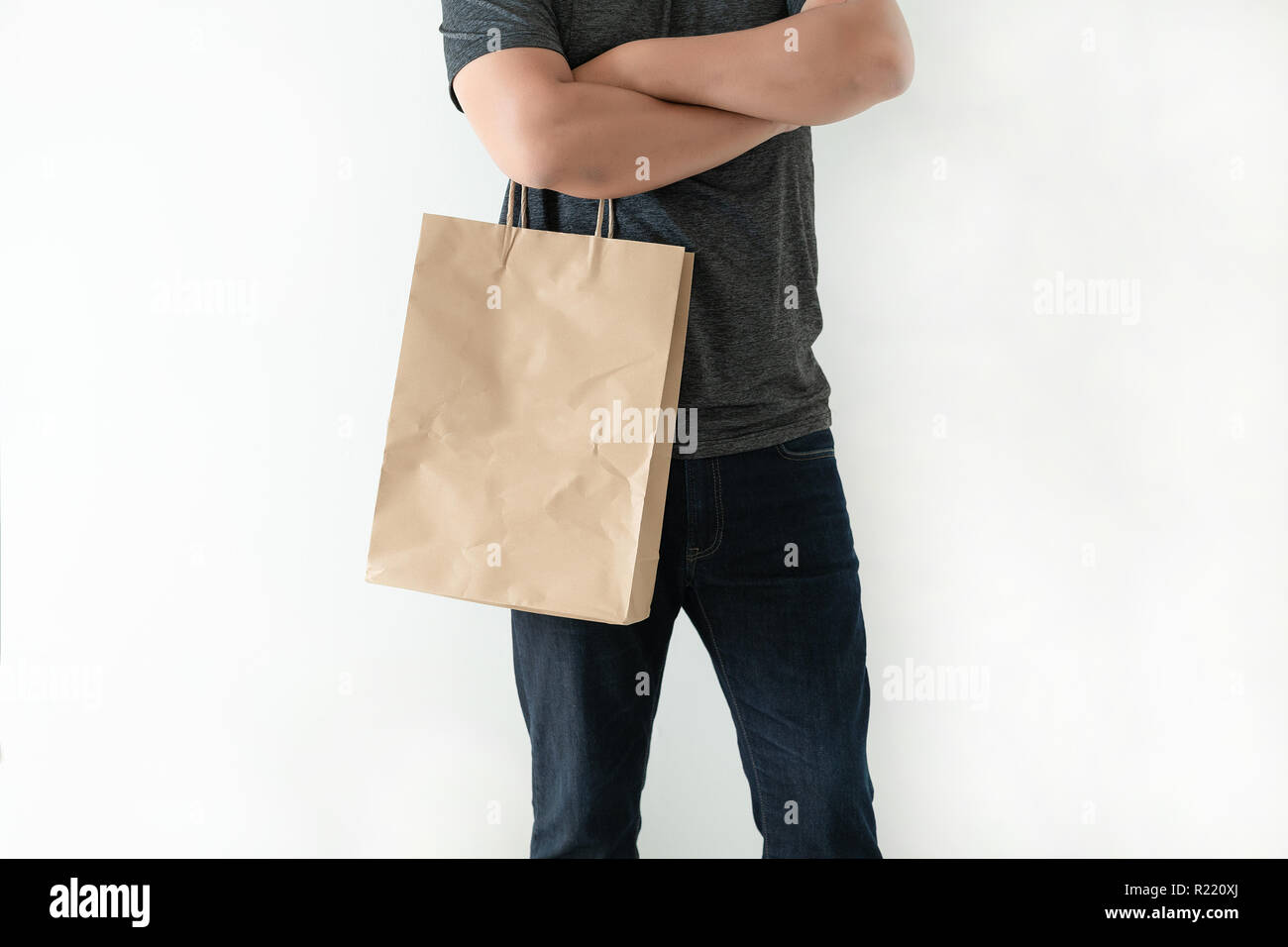 Consumer pack product Man shows bag mock up show Stock Photo