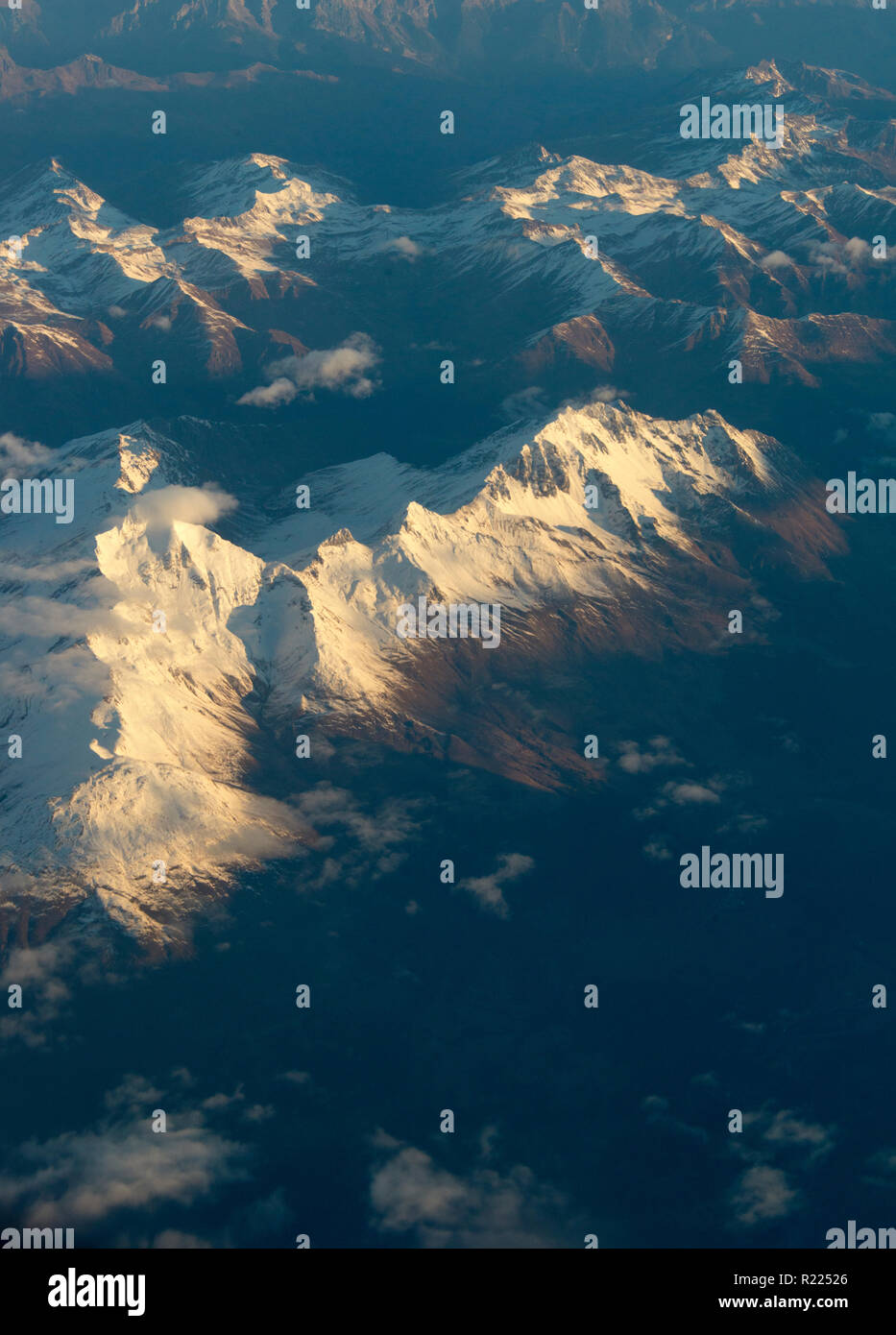 Arial photograph over Swiss Alps at daybreak - Stock Image