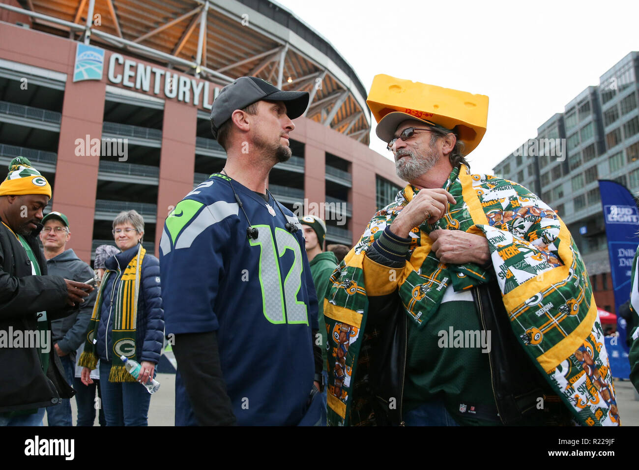 c2d8755da A Packers fan wearing a cheese head talks to a Seahawks fan prior to a game  between the Green Bay Packers and Seattle Seahawks at CenturyLink Field ...
