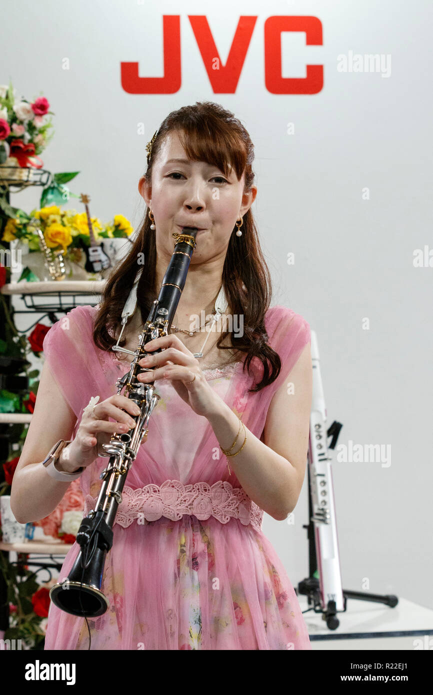 Tokyo, Japan. 15th November, 2018. A woman performs during the International Broadcast Equipment Exhibition (Inter BEE) 2018 at the International Convention Complex Makuhari Messe in Chiba. The exhibition shows the latest technologies for audio, video and communications in Japan and overseas including 16K displays and new camera equipment. Inter BEE is held from November 14 to 16. Credit: Rodrigo Reyes/Alamy Live News - Stock Image