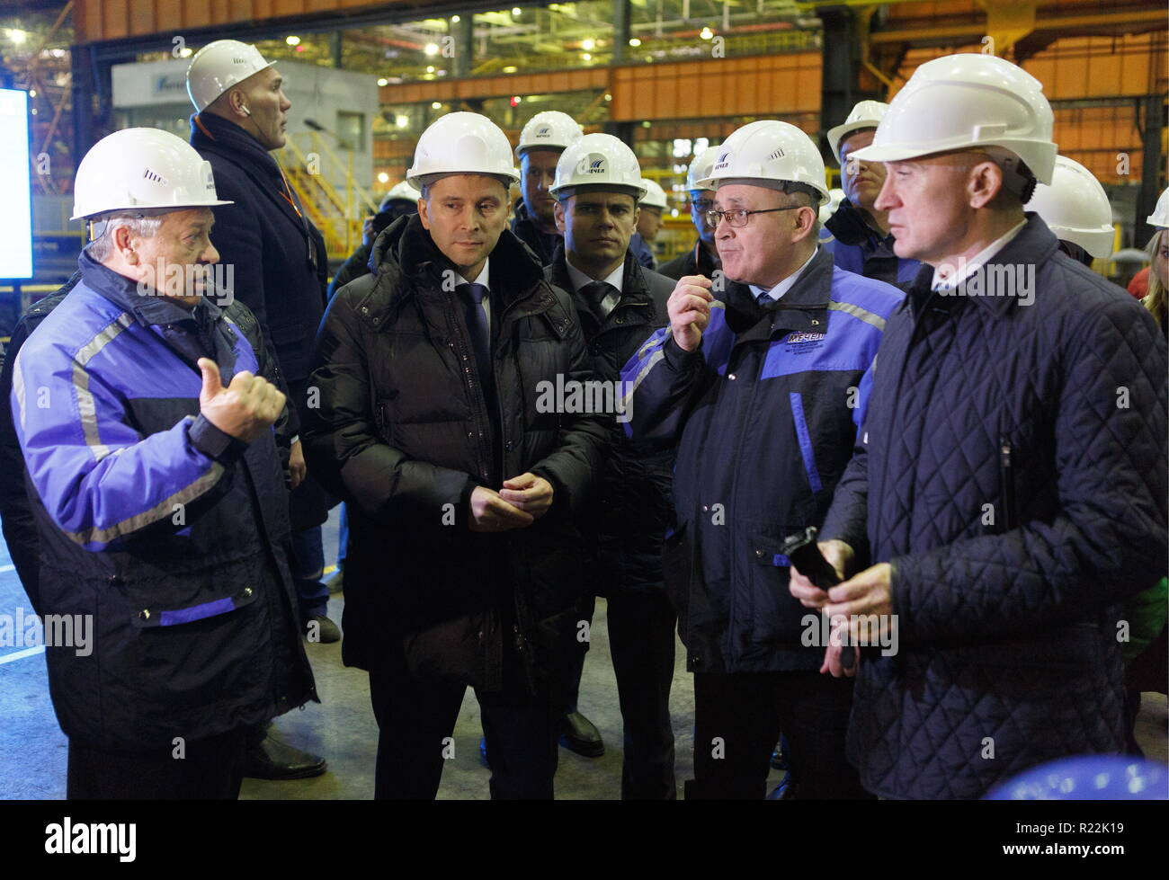 Chelyabinsk, Russia. 16th Nov, 2018. CHELYABINSK, RUSSIA - NOVEMBER 16, 2018: Chairman of the Board of Directors at Mechel Igor Zyuzin (L), Russia's Minister of Natural Resources and Environment, Dmitry Kobylkin (2nd L), and Chelyabinsk Region Governor Boris Dubrovsky (R) visit Chelyabinsk Coke and Chemical Products Plant (Mechel Coke) owned by Mechel, a major producer of metallurgical coal. Nail Fattakhov/TASS Credit: ITAR-TASS News Agency/Alamy Live News - Stock Image