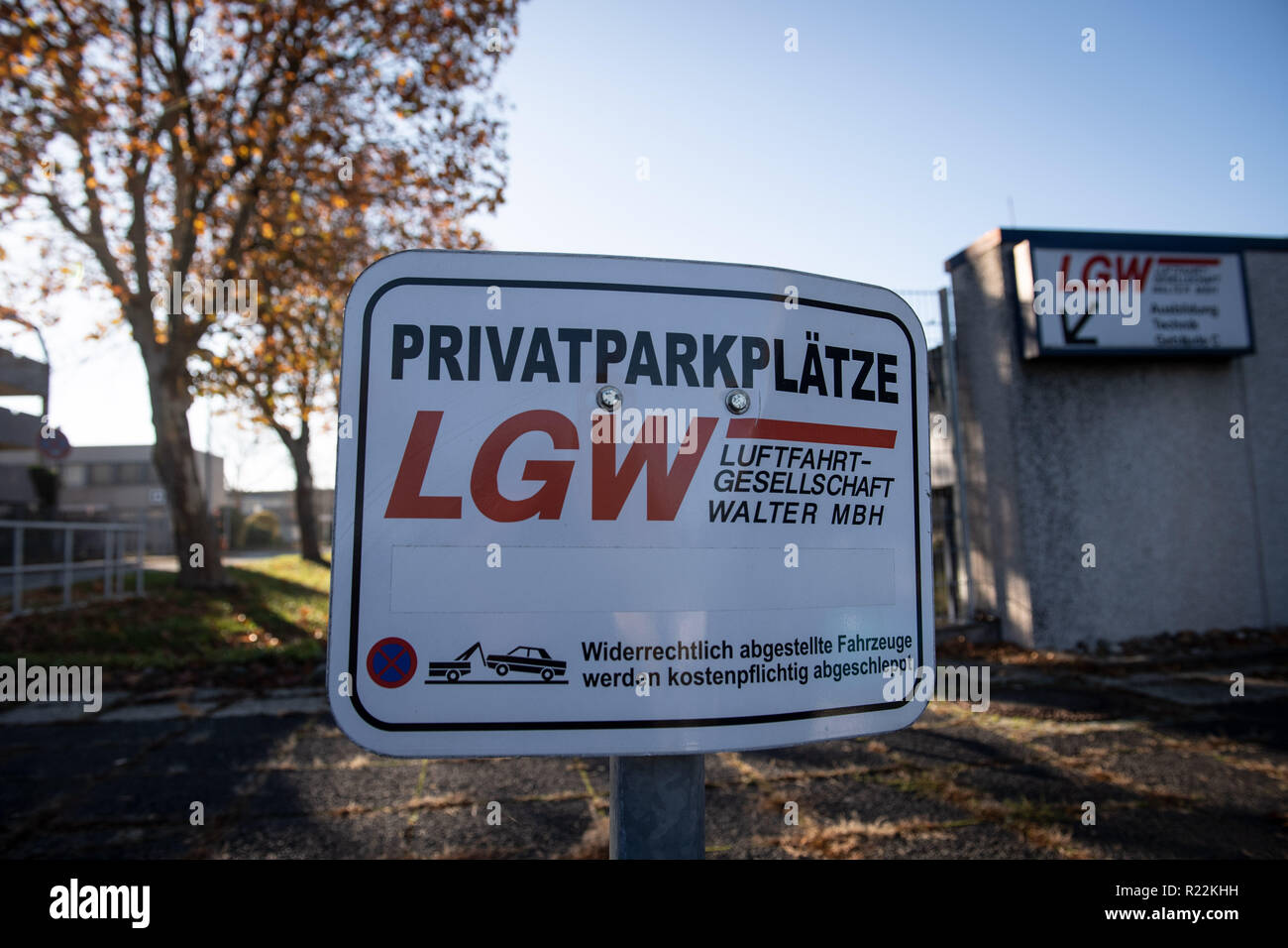 Dortmund, Germany. 16th Nov, 2018. The logo of Luftfahrtgesellschaft Walter (LGW) stands on a parking sign at a building of Dortmund Airport. One day after a general strike threat for the flight attendants of the Eurowings core company, the trade union verdi focuses on the aviation company Walter (LGW) based in Dortmund, which also flies for Eurowings. Credit: Bernd Thissen/dpa/Alamy Live News - Stock Image