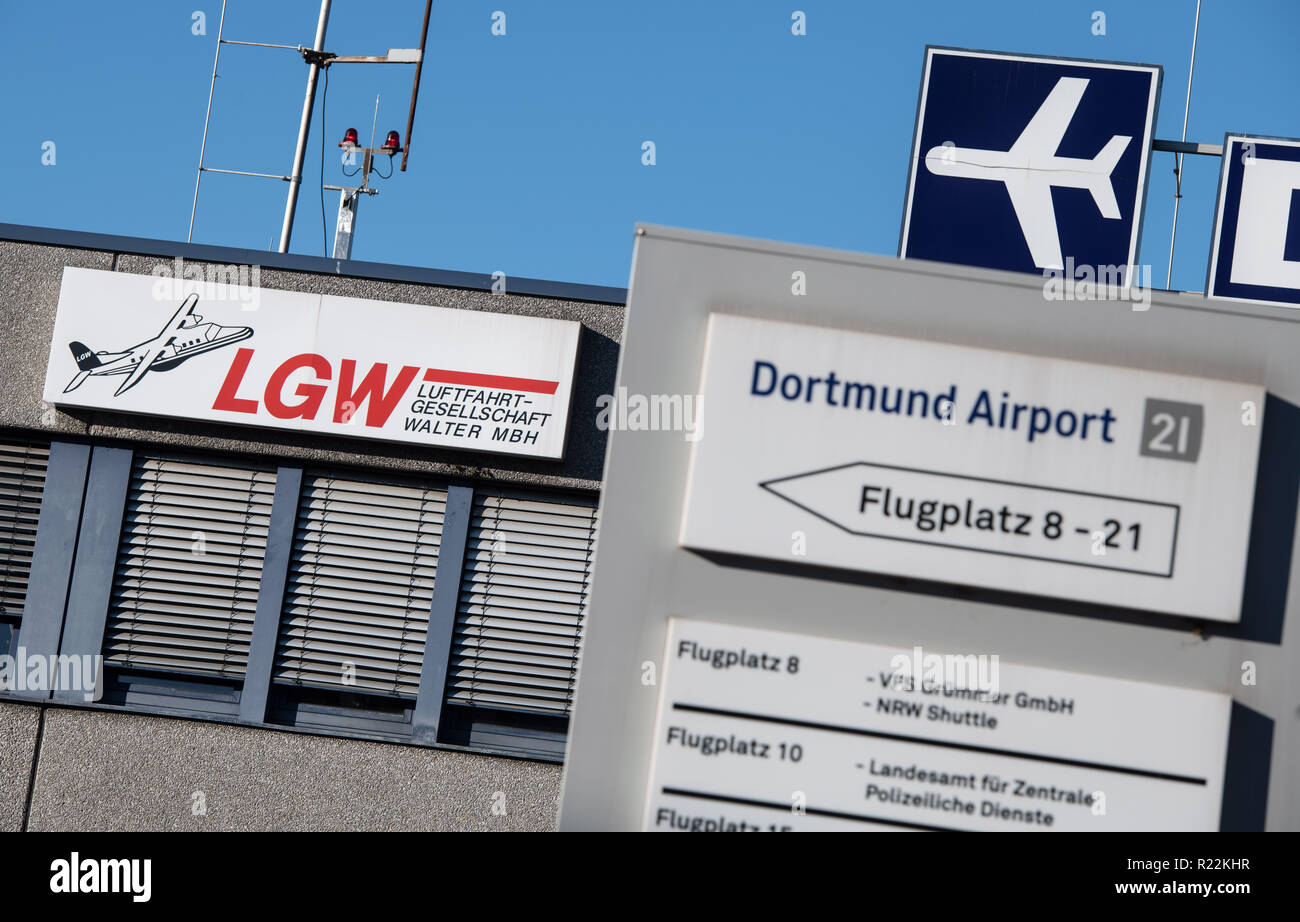 Dortmund, Germany. 16th Nov, 2018. The logo of Luftfahrtgesellschaft Walter (LGW) hangs on a building at Dortmund Airport. One day after a general strike threat for the flight attendants of the Eurowings core company, the trade union verdi focuses on the aviation company Walter (LGW) based in Dortmund, which also flies for Eurowings. Credit: Bernd Thissen/dpa/Alamy Live News - Stock Image