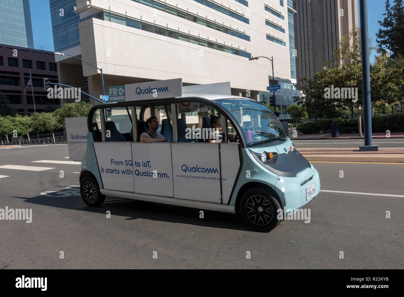 A Free Ride shuttle (a Polaris GEM Electric Vehicle)  in downtown San Diego, California, United States. - Stock Image